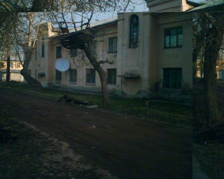 Спутниковая антенна среди трущоб